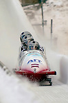 20 November 2005: Janis Minins, pilot of the Latvia 2 sled, crosses the finish line for a 10th place finish at the 2005 FIBT AIT World Cup Men's 4-Man Bobsleigh Tour at the Verizon Sports Complex, in Lake Placid, NY. Mandatory Photo Credit: Ed Wolfstein.
