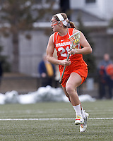 Syracuse University attacker/midfielder Kayla Treanor (21) on the attack.   Syracuse University (orange) defeated Boston College (white), 17-12, on the Newton Campus Lacrosse Field at Boston College, on March 27, 2013.