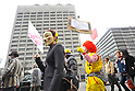 Tokyo, Japan - March 11: Hundreds of thousands of people walked in front of the building of Ministry of Economy, Trade and Industry during a demonstration against nuclear power plants at Chiyoda, Tokyo, Japan on March 11, 2012. As this day was one year anniversary of Great East Japan Earthquake and Tsunami, there were many demonstrations held in the city.