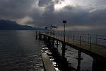 Pier under stormy clouds on lake Léman, Vevay, close to Montreux,Lausanne, Switzerland.