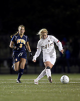 """Boston College midfielder Kate McCarthy (21) passes the ball. Boston College defeated West Virginia, 4-0, in NCAA tournament """"Sweet 16"""" match at Newton Soccer Field, Newton, MA."""