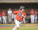Mississippi's Miles Hamblin (24) hits a solo home run vs. St. John's during an NCAA Regional at Davenport Field in Charlottesville, Va. on Friday, June 4, 2010.