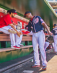23 May 2015: Washington Nationals outfielder Michael Taylor gets a greeting from Gio Gonzalez in the dugout prior to a game against the Philadelphia Phillies at Nationals Park in Washington, DC. The Phillies defeated the Nationals 8-1 in the second game of their 3-game weekend series. Mandatory Credit: Ed Wolfstein Photo *** RAW (NEF) Image File Available ***