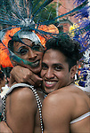 Half length portrait of gay couple at the end of the Gay Pride March pose for the camera in New York City