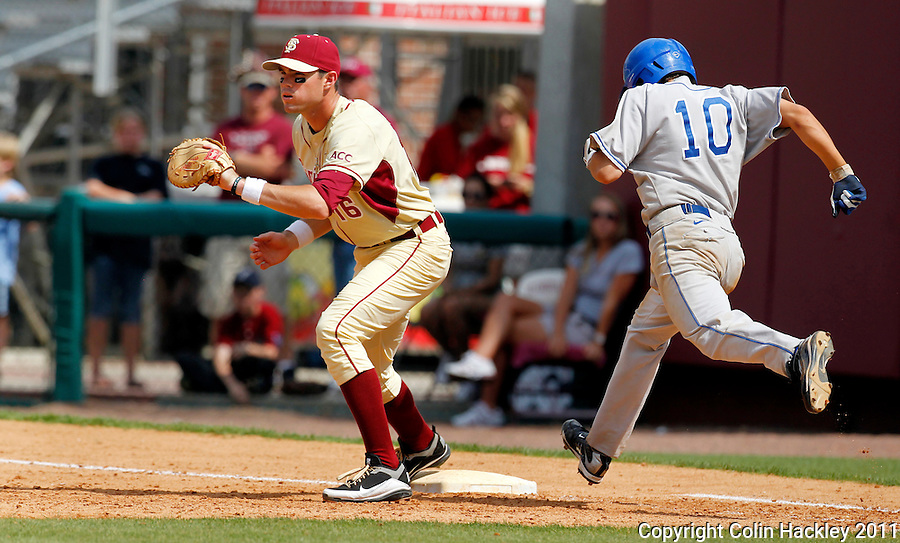 TALLAHASSEE, FL 4/24/11-FSU-DUKE BASE11 CH- Duke's Angelo LaBruna can't make it to first base before Florida State's Jayce Boyd tags the bag in the ninth inning Sunday at Dick Howser Stadium in Tallahassee. The Seminoles beat the Blue Devils 13-9...COLIN HACKLEY PHOTO