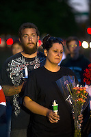 BURLINGTON, WA - SEPTEMBER 26:  Jeff Huson and his wife Samantha Huson, from Burlington, Washington join hundreds in a candlelight vigil outside the Cascade Mall on September 26, 2016 in Burlington, Washington. Five people were killed by a gunman several nights ago. The suspect, Arcan Cetin, 20, a resident of Oak Harbor, Washington, was arraigned today. (Photo by Karen Ducey/Getty Images)