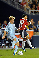 Seth Sinovic (15) Sporting KC, Jesus Sanchez (17) Chivas Guadalajara in action... Sporting Kansas City and Chivas Guadalajara played to a 2-2 tie in an international friendly at LIVESTRONG Sporting Park, Kansas City, Kansas.