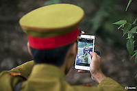 """An actor dressed as a Japanese World War Two army officer checks a picture of himself shot with a phone on the set of """"The Last Prince"""" television series on location near Hengdian World Studios near Hengdian July 24, 2015. Hundreds of well-trained actors and other professionals are available at the Hengdian World Studios. The well-organised team coordinate complicated battle scenes to satisfy the huge appetite for productions about the war against Japan. Director Li Xiaoqiang said the series is about a Qing Dynasty prince, who joined the Chinese nationalist army after suffering family misfortune. """"After he learnt more about the Communist Party, the prince began to understand what real revolution and the anti-Japanese war meant, and turned to the Communist Party to fight Japan"""", the director added. According to local media, more than 10 new movies, 12 TV dramas, 20 documentaries and 183 war-themed stage performances will be released in China to coincide with the 70th anniversary of the end of World War Two. REUTERS/Damir SagoljPICTURE 17 OF 28 FOR WIDER IMAGE STORY """"BEHIND THE SCENES OF A CHINESE WAR DRAMA"""".SEARCH """"SAGOLJ STUDIO"""" FOR ALL PICTURES.      TPX IMAGES OF THE DAY"""