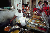 --- Women cook Bahian specialties at a street stand in Salvador, Brazil. Bahian food is a blend of Brazilian and African flavors. Photograph by &copy; Owen Franken
