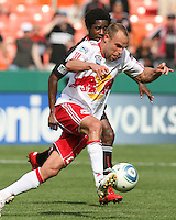 Clyde Simms #19 of D.C. United follows Joel Lindpere #20 of the New York Red Bulls during an MLS match on May 1 2010, at RFK Stadium in Washington D.C.