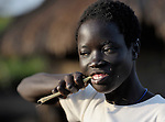 Twelve-year old Charty Moriba, a United Methodist, cleans her teeth in the morning in Pisak, a village in Southern Sudan.