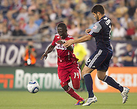 Chicago Fire midfielder Patrick Nyarko (14) on the attack. In a Major League Soccer (MLS) match, the New England Revolution tied the Chicago Fire, 1-1, at Gillette Stadium on June 18, 2011.