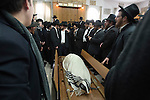 Ultra-orthodox Jewish men gather around the body of Rabbi Refoel Shmulevitz, wrapped in a prayer shawl, during his funeral in Jerusalem, Israel. Rabbi Shmulevitz was the head of Mir Yeshiva, one of the largest Yeshivas in Israel with more than 7500 students coming from all over the world.