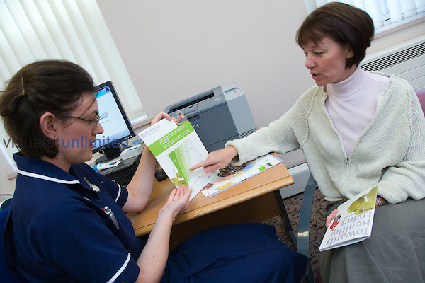 Patient looking at BMI chart with community nurse. MR