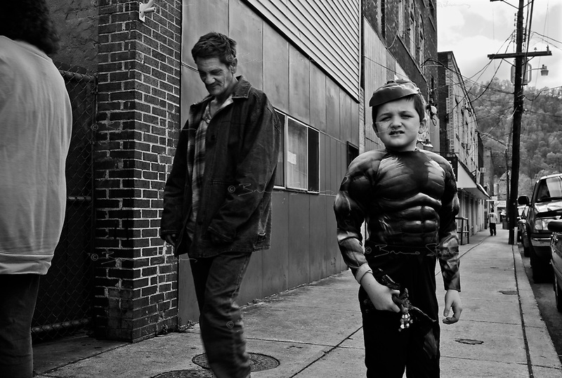 """War, WV, October 25 2008.Tyler, 8, dressed as the Incredible Hulk, on the way to a Halloween party..""""West Virginia Southernmost city"""", War is a small coal miners' town, hit hard by the economic crisis; many of its inhabitants will vote for Obama as McCain is perceived to be the man from the oil companies, trying to destroy the coal mining industry."""