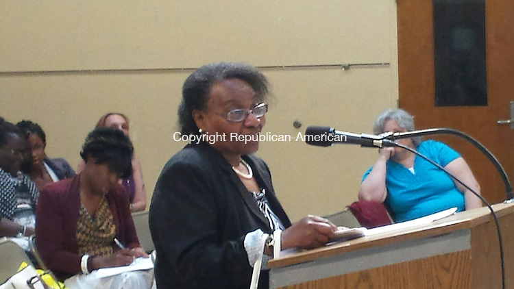 WATERBURY - Bunker Hill Elementary School Library Page Lois McClain was among a group urging the Board of Education Thursday to avoid a proposed cut of 17 library pages from city schools.