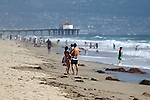 MANHATTAN BEACH, CALIFORNIA, USA – JUNE 20, 2013. Children play on El Porto beach at the beginning of summer on June 20, 2013. El Porto is popular because an underwater canyon creates large waves.