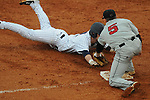 Ole Miss' Alex Yarbrough (2) is tagged out by Arkansas State third baseman Zach Maggio at Oxford University Stadium in Oxford, Miss. on Wednesday, February 23, 2011.