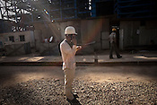 Li Qi, a motion engineer from SEPCO, operating a crane at the plant site and directing nearby Indian workers at the construction site of the Adani Power plant of 4620 MW capacity in Mundra port industrial city of Gujarat, India. Indian power companies have handed out dozens of major contracts to Chinese firms since 2008. Adani Power Ltd have built elaborate Chinatowns to accommodate Chinese workers, complete with Chinese chefs, ping pong tables and Chinese television. Chinese companies now supply equipment for about 25% of the 80,000 megawatts in new capacity.