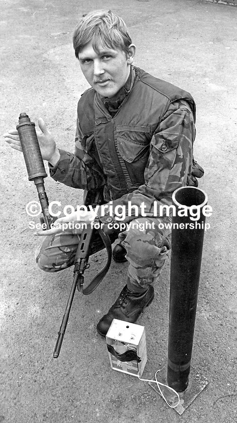 Gary Walters, stationed RAF Aldergrove, N Ireland, displays the mortar launcher he discovered mounted on a lorry at the perimeter of Belfast International Airport. The airport is shared with RAF, Royal Air Force. 6th March 1976. 197603070149<br /> <br /> Copyright Image from Victor Patterson, 54 Dorchester Park, Belfast, UK, BT9 6RJ<br /> <br /> Tel: +44 28 9066 1296<br /> Mob: +44 7802 353836<br /> Voicemail +44 20 8816 7153<br /> Skype: victorpattersonbelfast<br /> Email: victor@victorpatterson.com<br /> Email: victorpatterson@me.com (back-up)<br /> <br /> IMPORTANT: If you wish to use this image or any other of my images please go to www.victorpatterson.com and click on the Terms &amp; Conditions. Then contact me by email or phone with the reference number(s) of the image(s) concerned.
