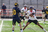 College Park, MD - April 1, 2017: Maryland Terrapins Isaiah Davis-Allen (26) blocks a shot attempt by Michigan Wolverines Ian King (10) during game between Michigan and Maryland at  Capital One Field at Maryland Stadium in College Park, MD.  (Photo by Elliott Brown/Media Images International)