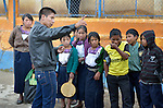 Estuardo Aguilon speaks to a group of school children in Tuixcajchis, a small Mam-speaking Maya village in Comitancillo, Guatemala. Aguilon is an agricultural specialist with the Maya Mam Association for Investigation and Development (AMMID), which helps the students learn about nutrition as they prepare and cook vegetables during class.
