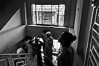 Christian followers pray in the corridor during the Sunday mass in Delmas, Port-au-Prince, Haiti, 8 July 2008. The Sunday mass starts early in the morning, worshippers come formally dressed, older women keep their hair covered. Religious songs and prayings sung by hundreds of followers are heard in the whole neighbourhood of Delmas.