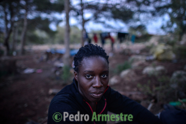 Amina is 25 years old and she is from Senegal. She had to leave her five-year-old in her country to make the trip towards Europe. She is the only woman of the group of Sub-Saharan immigrants who survive in the mount Gurugú, in Morocco. Amina has tried to jump once the fence to cross to Melilla (Spain) without success. Near 400 sub-Saharan immigrants survive in the mount Gurugú, in Morocco, waiting of an opportunity to jump the fence that separates them from Melilla, Spain, and from their dream of being employed at Europe. Many of them, between which there are minors, denounce violence from the police and the Moroccan army. October 28, 2012. © Pedro ARMESTRE