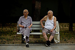 Two men watch morning exercises at Yuyuantan Park in Beijing, China on Tuesday, August 5, 2008. The city of Beijing is gearing up for the opening ceremonies of the Olympic Games.  Kevin German