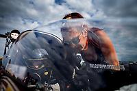 Apr 22, 2017; Baytown, TX, USA; NHRA top fuel driver Scott Palmer talks with crew chief Ashley Fye during qualifying for the Springnationals at Royal Purple Raceway. Mandatory Credit: Mark J. Rebilas-USA TODAY Sports