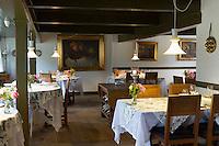 Sonderho Kro Hotel and Restaurant with quaint tables and chairs furniture, Fano Island, South Jutland, Denmark