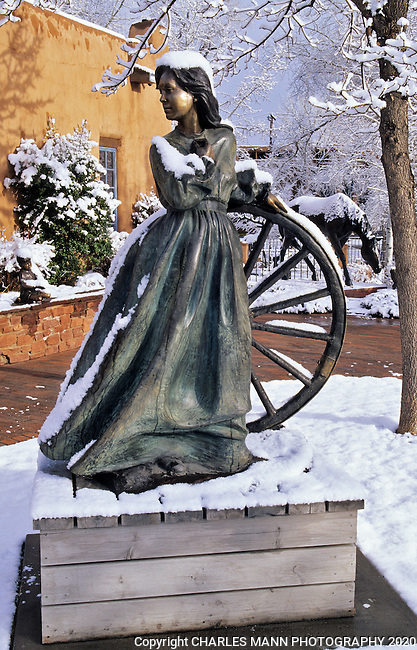 A sculpture in a Canyon Road gallery garden takes on a romantic aura during a winter snowfall in Santa Fe, New Mexico