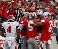 Ohio State Buckeyes quarterback Braxton Miller (5) celebrates with teammates after scoring a touchdown in the second quarter of Saturday's NCAA Division I football game against Indiana at Ohio Stadium in Columbus on November 23, 2013. (Barbara J. Perenic/The Columbus Dispatch)