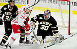 2 January 2011: Army Black Knight goaltender Ryan Leets, a Sophomore from Kentwood, MI, stops Ohio State University Buckeye forward Alex Szczechura, a Freshman from  Brantford, Ontario, at Gutterson Fieldhouse in Burlington, Vermont. The Buckeyes defeated the Black Knights 5-3 to win the 2010-2011 Catamount Cup. Mandatory Credit: Ed Wolfstein Photo