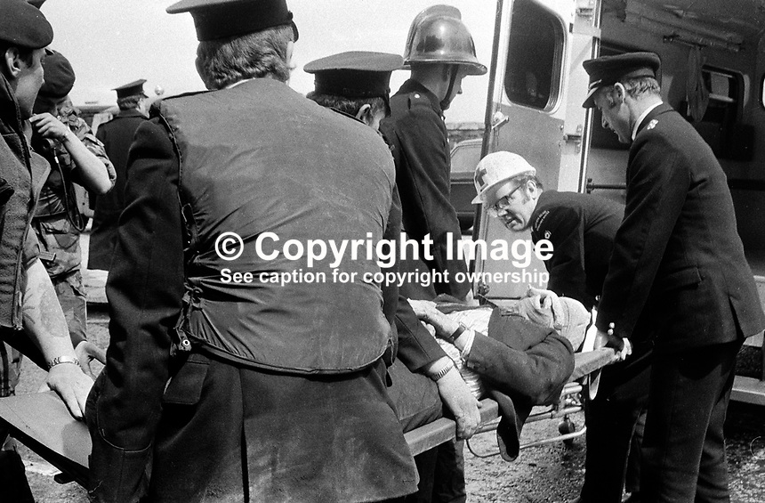 Policeman, fireman and ambulancemen carefully stretcher an explosion victim into a waiting ambulance. In the no-warning IRA explosion in Oxford Street, Belfast, N Ireland, UK, one woman died and several others were seriously injured. 197205260296d..Copyright Image from Victor Patterson, 54 Dorchester Park, Belfast, UK, BT9 6RJ..Tel: +44 28 9066 1296.Mob: +44 7802 353836.Voicemail +44 20 8816 7153.Skype: victorpattersonbelfast.Email: victorpatterson@mac.com.Email: victorpatterson@ireland.com (back-up)..IMPORTANT: If you wish to use this image or any other of my images please go to www.victorpatterson.com and click on the Terms & Conditions. Then contact me by email or phone with the reference number(s) of the image(s) concerned.