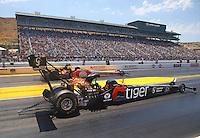 Aug 1, 2015; Sonoma, CA, USA; NHRA top fuel driver Larry Dixon (near) races alongside Doug Kalitta during qualifying for the Sonoma Nationals at Sonoma Raceway. Mandatory Credit: Mark J. Rebilas-
