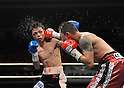 (L-R) Hiroyuki Hisataka (JPN), Hugo Cazares (MEX), DECEMBER 23, 2010 - Boxing : Hugo Fidel Cazares of Mexico hits Hiroyuki Hisataka of Japan during the 12th round of the WBA super flyweight title bout at Osaka Prefectural Gymnasium in Osaka, Osaka, Japan. (Photo by Mikio Nakai/AFLO).
