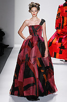 Model walks runway in a brilliant brush strokes silk organza Gstaad ball gown w/attached beaded black mini skirt+crystal encrusted one-shoulder trail, from the Zang Toi Fall 2012 &quot;Glamour At Gstaad&quot; collection, during Mercedes-Benz Fashion Week New York Fall 2012 at Lincoln Center.