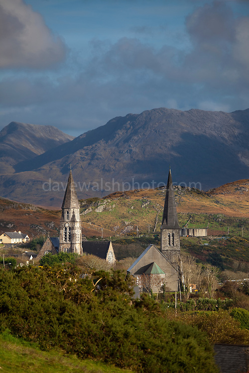 """The town of Clifden, in Connemara, Co. Galway, the """"capital of Connemara"""". It's a market town founded in the early 19th century by John D'Arcy. The Twelve Bens, or Pins mountains are in the background, behind the twin church spires."""