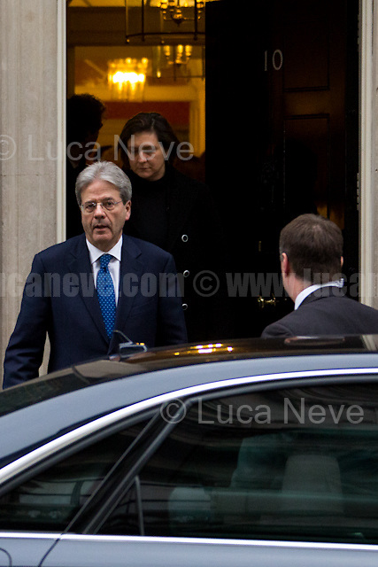 Italian Prime Minister, Paolo Gentiloni.<br /> <br /> London, 09/02/2017. Today, The Italian Prime Minister, Paolo Gentiloni, visited 10 Downing Street where he had a meeting with the British Prime Minister Theresa May. Noticeably, the Italian Prime Minister used - again (His predecessor and leader of the PD - Democratic Party - Matteo Renzi started this &quot;tradition&quot; to visit 10 Downing Street with a non-Italian car in 2014 replacing the official Maserati Quattroporte - number plate &quot;Ita 1&quot; - with a Chrysler 300c made by FCA, Fiat Chrysler Automobiles. FIAT - Aka Fabbrica Italiana Automobili Torino - moved its tax domicile from Italy to the UK just the day before - see my story here https://goo.gl/hH5a6O) - a different car for his official visit in the UK. In fact, this time the official Maserati Quattroporte &quot;Ita 1&quot;, was replaced by an Audi A8L 6.3 W12 quattro, a luxury car produced by the German and world leader of the car industry, Volkswagen Group.