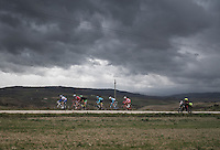 the early breakaway group being chased by heavy clouds<br /> <br /> 11th Strade Bianche 2017