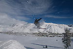 A  young skier takes off on a backcountry jump near Sun Valley Idaho. Model released.