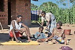 Florence Shawa (standing) serves dinner to her family in their village of Thundira, in northern Malawi.