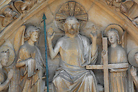 Christ enthroned, showing his wounds from the crucifixion, flanked by 2 angels holding instruments of the Passion (spear, nails, cross), the Virgin and St John the Baptist, from the tympanum of the Last Judgment Portal, the central portal on the Western facade, built 1220-30, Notre Dame, Ile de la Cite, Paris, France. Angels watch from the surrounding archivolts. The portal represents the Last Judgment according to the Evangelist St Matthew. The cathedral was built 1160-1345 and listed as a UNESCO World Heritage Property in 1991 as part of the Banks of the Seine. Picture by Manuel Cohen.