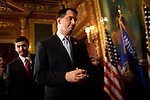 Wisconsin Governor Scott Walker leaves a press conference at the State Capitol in Madison, Wisconsin, February 23, 2011.