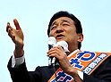 April 7, 2011, Tokyo, Japan - Japanese business entrepreneur Miki Watanabe, running for governor of Tokyo, addresses a crowd of cherry blossoms viewers during his street campaign at Tokyo's Ueno Park on Thursday, April 7, 2011. Watanabe, the founder of a chain of casual pubs, is running in the April 10 Tokyo gubernatorial election, attempting to make the big jump from business manager to big-time politician. (Photo by AFLO) [3609] -mis-.