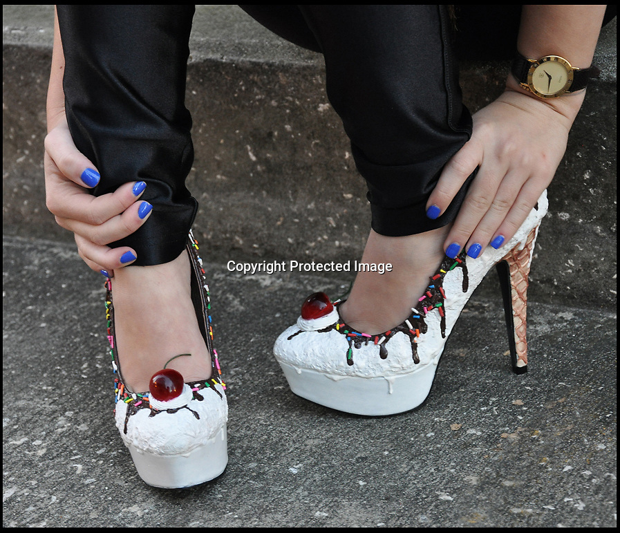 BNPS.co.uk (01202 558833)<br /> Pic: ShoeBakery/BNPS<br /> <br /> ***Please use full byline***<br /> <br /> Every girl's dream...<br /> <br /> A fashion designer has come up with the perfect footwear for women - heels that look like they are made of cake and icing.<br /> <br /> Chris Campbell, 29, has expertly painted dozens of pairs of shoes so they appear to be decorated with buttercream, sprinkles, chocolate and cherries.<br /> <br /> He even applies three dimensional sculptures to the footwear so they look like cherries and dollops of ice-cream.<br /> <br /> Chris has now set up his own shop, The Shoe Bakery, selling the mouth-watering heels and ballet pumps.<br /> <br /> Some of his designs include cookies, chocolate and sponge cakes, ice-cream sundaes, red velvet cake, and gingerbread.<br /> <br /> The shoes are so realistic that Chris has received enquiries from people asking if they are edible.<br /> <br /> The creations are applied to the shoes with the actual tools used by bakers such as a piping bag and each pair can take between two and four weeks to complete.