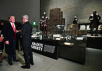 United States President Donald Trump visits the Smithsonian National  Museum of African American History and Culture in Washington, DC on February 21, 2017.  The &quot;Paradox of Liberty&quot; exhibit at right shows President Thomas Jefferson and other American leaders with slaves, each brick being a slave.   <br /> Credit: Kevin Dietsch / Pool via CNP /MediaPunch