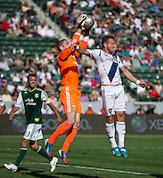 CARSON, CA - June 17, 2012: Portland Timbers goalie Troy Perkins (1) and LA Galaxy forward Chad Barrett (9) during the LA Galaxy vs Portland Timbers match at the Home Depot Center in Carson, California. Final score LA Galaxy 1, Portland Timbers 0.