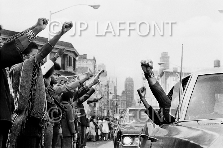 Brooklyn, New York City, NY. September  25th 1971.<br /> Black people hold the Black Panther salute in tribute to the six black prisoners found dead at Attica Prison, during the funeral held in Brooklyn.
